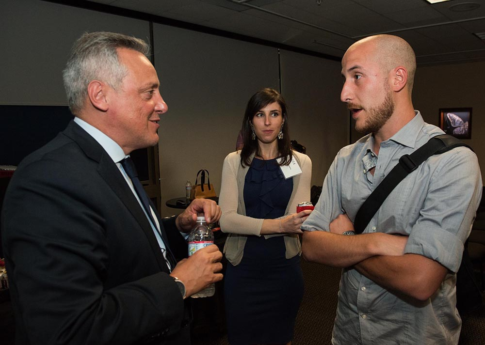 Alberto Milani, CEO of Buccellati Americas, speaks with a GIA student during a special student screening of Masters of Dreams the afternoon of Sept. 18. Image © GIA.